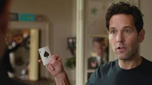 A photo of actor Paul Rudd portraying the character Scott Lang in Ant Man 2, holding a playing card