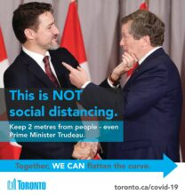 "A poster of John Tory and Justin Trudeau shaking hands, labeled ""This is not social distancing"""